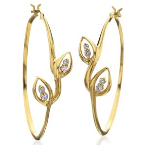 18 Karat gold and diamond hoops by Nicole Landaw, $2800 retail