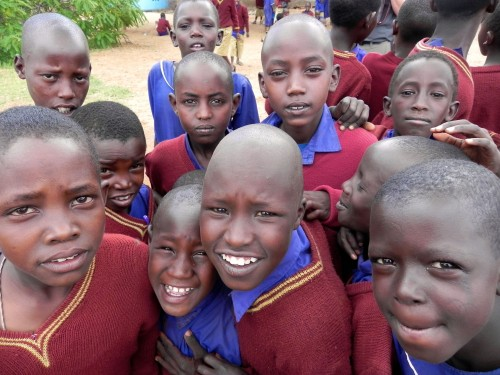 Maasai Schoolchildren Sharing the Rough